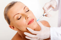 Woman face injection Stock Photos