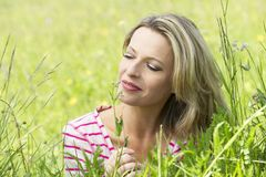 Pretty middle aged woman relaxes Royalty Free Stock Image