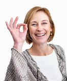 Pretty middle aged woman showing the ok sign Royalty Free Stock Images