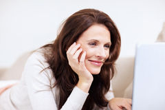 Pretty middle aged woman using laptop Stock Photography