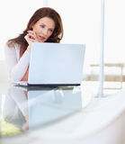 Pretty middle aged woman using laptop at home Royalty Free Stock Images