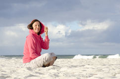 Pretty middle aged woman windy weather at ocean Royalty Free Stock Photography