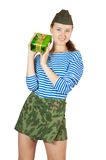 Pretty military girl with present Stock Image