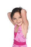Pretty mixed race girl with arms raised Stock Image