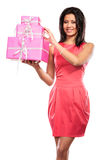 Pretty mixed race girl with boxes gifts. Christmas Royalty Free Stock Photo
