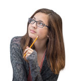 Pretty Mixed Race Girl Thinking with Pencil Stock Images