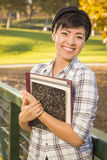 Pretty Mixed Race Teenage Student Holding Books Royalty Free Stock Images