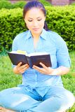 Pretty Mixed Race Woman Reading The Holy Bible Stock Images