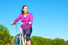 Pretty Mixed Race Woman Riding Bike On The Trail Royalty Free Stock Images