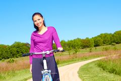 Pretty Mixed Race Woman Riding Bike On The Trail Stock Image