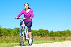 Pretty Mixed Race Woman Riding Bike On The Trail Stock Photo