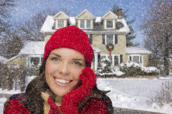 Pretty Mixed Race Woman in Winter Clothing Outside in Snow Royalty Free Stock Image