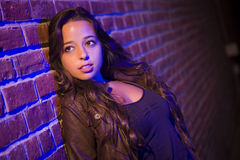 Pretty Mixed Race Young Adult Woman Against a Brick Wall Royalty Free Stock Photos