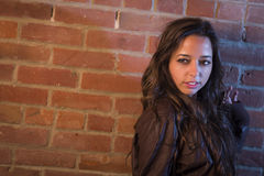 Pretty Mixed Race Young Adult Woman Against a Brick Wall Royalty Free Stock Photo