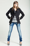 Pretty model in a black coat Stock Image