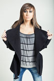 Pretty model in a black coat Royalty Free Stock Photos