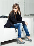 Pretty model in a black coat Stock Photos