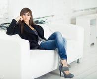Pretty model in a black coat Royalty Free Stock Image