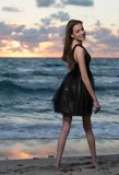 Pretty model in a black dress. Stock Images