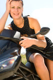 Pretty model with black motorcycle Stock Photography