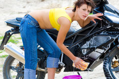 Pretty model with black motorcycle Royalty Free Stock Photo