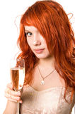 Pretty model cheering. Pretty model with a glass of champagne Stock Image