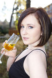 Pretty model drinking wine Stock Images