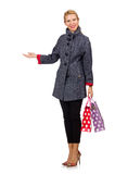 The pretty model in gray coat after shopping isolated on white Royalty Free Stock Image