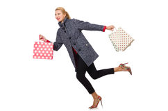 The pretty model in gray coat after shopping isolated on white Stock Images