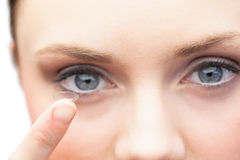 Pretty model holding contact lens Royalty Free Stock Images
