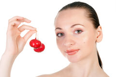 Pretty model holding radish in her mouth Royalty Free Stock Images