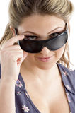 Pretty model holding sunglasses Stock Photos
