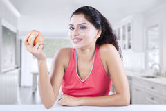 Pretty model holds apple at home Stock Photos