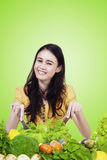 Pretty model makes vegetable salad Stock Photography