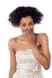 Pretty model in party wear stifling her giggle Royalty Free Stock Photography