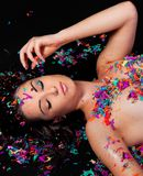 Pretty Model Playing With Bright Confetti Stock Image