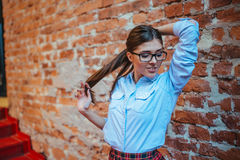 Pretty model posing near brick wall in a cafe.Art processing and Royalty Free Stock Photo