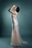 Pretty model posing in wedding dress with crystals Royalty Free Stock Image