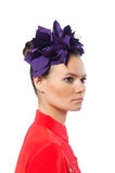 The pretty model with purple head accessory isolated on white. Pretty model with purple head accessory isolated on white Stock Photography