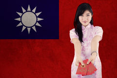 Pretty model shows envelope with flag of Taiwan Stock Image