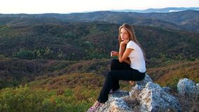 Pretty Model Sitting On The Rock stock footage