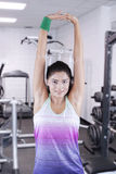 Pretty model stretching hands in the fitness center Stock Photos