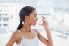 Pretty model using her asthma atomizer Stock Photos