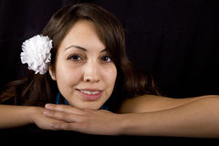 Pretty model with white flower in her hair. A pretty hispanic model with a white flower in her hair Royalty Free Stock Photography