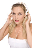 Pretty model with white headphone. Women listenig to music in white headphone stock photography