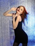 Pretty model woman dancing to music at disco Stock Photos