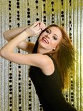 Pretty model woman dancing to music at disco Royalty Free Stock Image