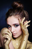 Pretty Model Woman with Golden Skin with Stars. And Glamorous Makeup. Face closeup stock photography