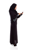 Arabian woman cell. Pretty modern arabian woman using cell phone on white Royalty Free Stock Photos