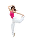 Pretty modern dancer girl jumping dancing. Pretty modern dancer slim hip-hop style teenage girl jumping dancing isolated on a white studio background Stock Image